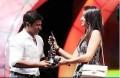 Puneeth recieving 59th South Filmfare Award